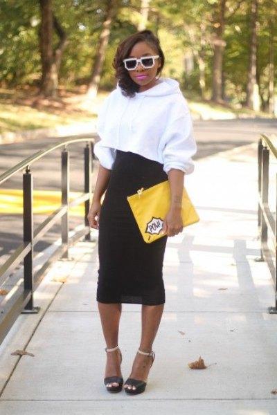 white cropped hoodie black high waisted midi skirt
