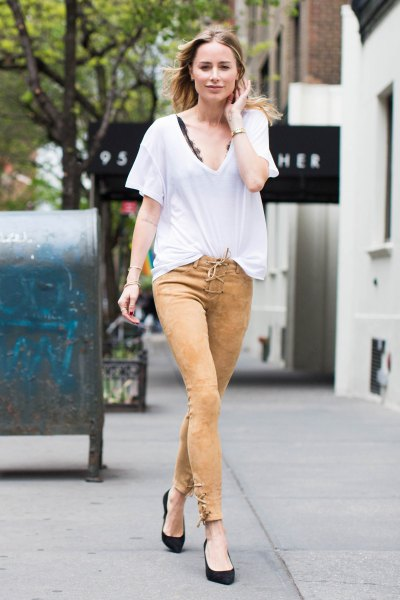 white oversized t shirt green skinny pants