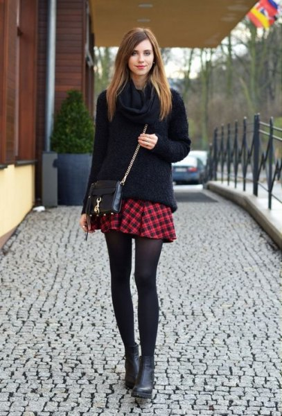 black chunky knit sweater mini red plaid skirt