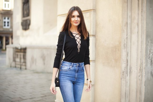 black lace up top blue washed skinny jeans