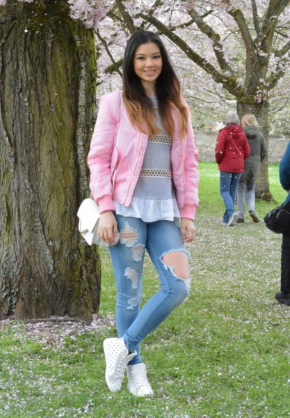 grey and white peplum top ripped skinny jeans
