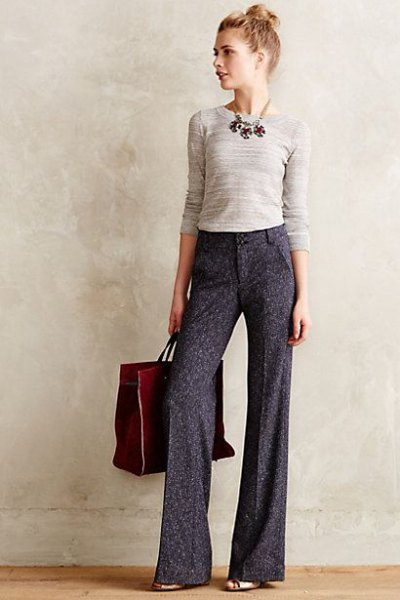 pale pink form fitting sweater grey wide leg dress pants
