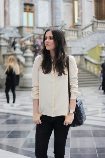 pale yellow silk shirt dark blue skinny jeans