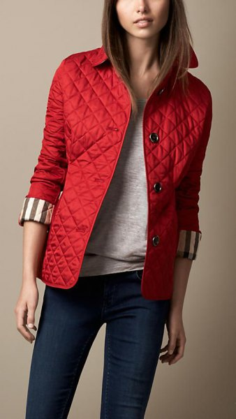 red quilted jacket dark blue skinny jeans