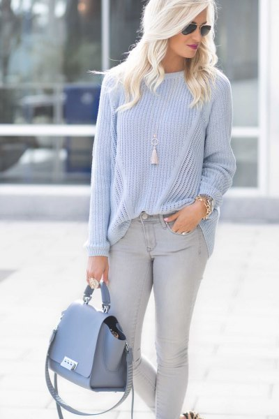 teal crew neck sweater light blue skinny jeans