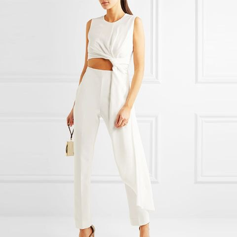 white asymmetric cropped draped top