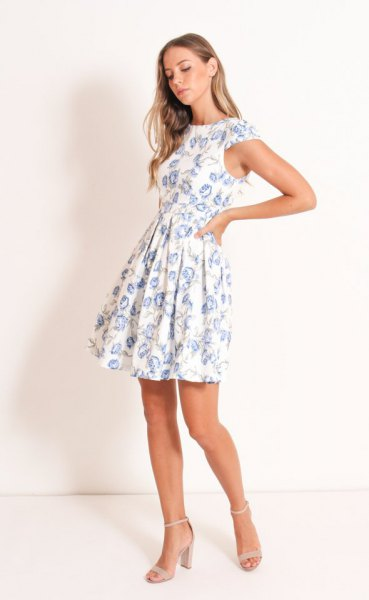 white floral cap sleeve fit and flare mini dress