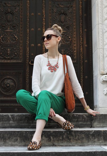 white knit sweater green khaki pants