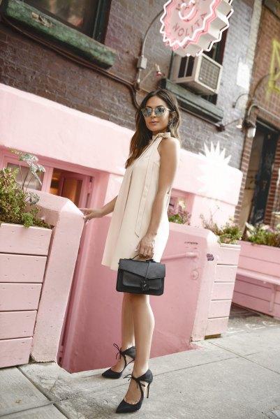 white sleeveless smock dress black heels