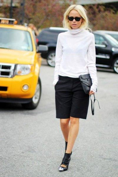 white turtle neck sweater black knee length shorts