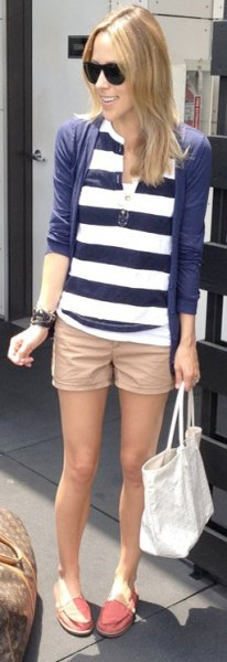beige khaki shorts with navy and white striped polo shirt