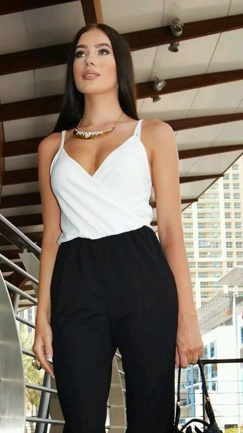 black and white jumpsuit crisscrossed