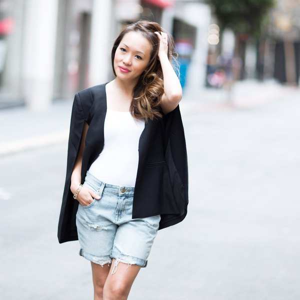 black cape blazer white vest top blue denim cropped shorts
