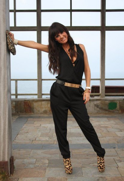 black jumpsuit with silver metallic belt