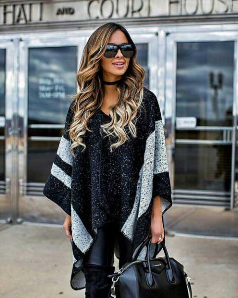 black knit poncho with wide wide stripes