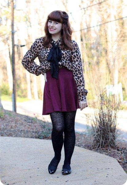 black pleated skater mini skirt patterned stockings