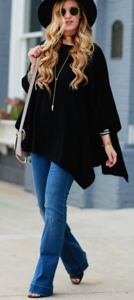black poncho blue flared jeans