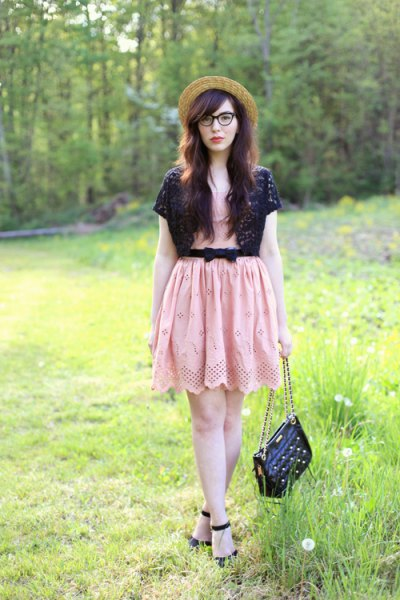 black shrug pink belted mini dress