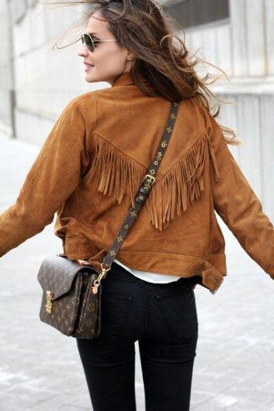 brown fringe suede jacket black skinny jeans