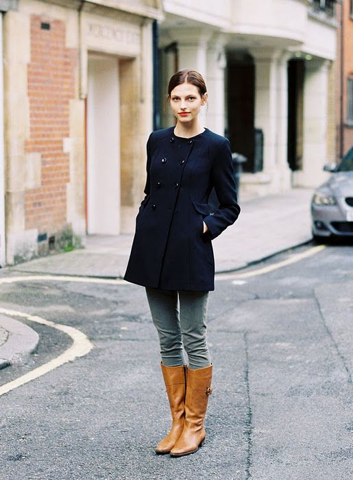 brown riding boots navy blue coat