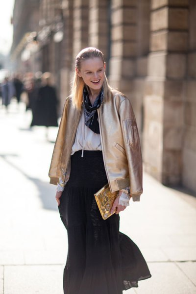 gold bomber jacket white blouse black chiffon skirt