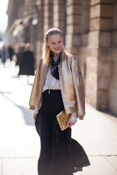 gold bomber jacket white blouse black chiffon skirt