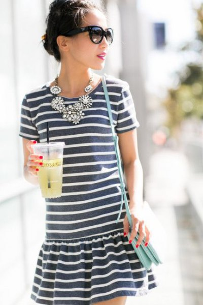 grey and white striped mini dress with statement necklace