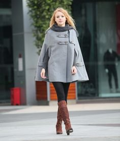 grey cape coat black leggings boots