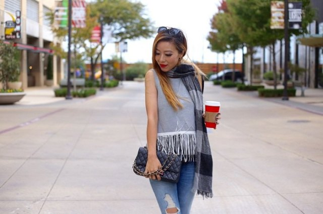grey sleeveless top with white fringes
