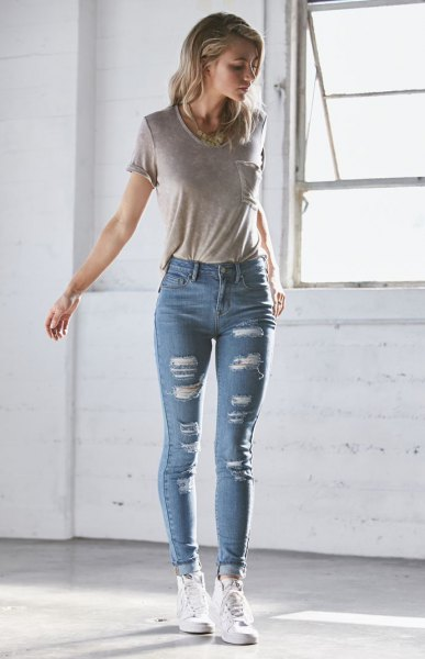 grey t shirt ripped blue skinny stretch jeans