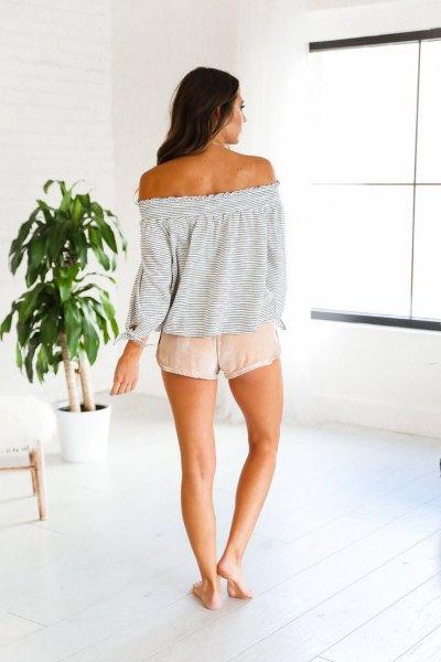 light grey off shoulder sweater pink shorts