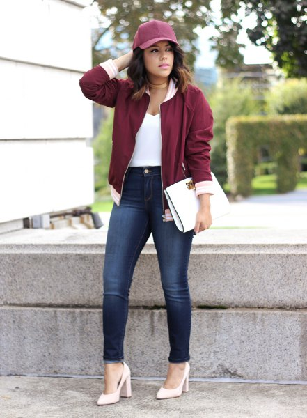 maroon jacket white pointed toe pumps grey baseball cap