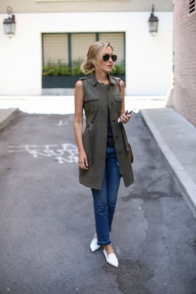 olive green long vest dark blue skinny jeans