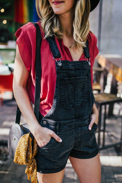 red cap sleeve blouse black denim overall shorts