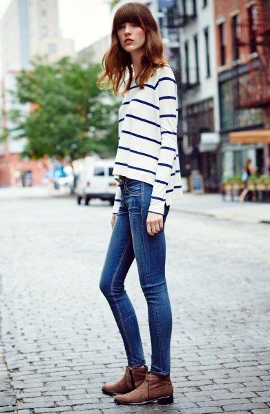 white and navy striped long sleeve top blue skinny stretch jeans
