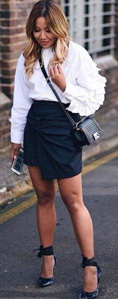 white blouse black high waisted mini wrap skirt