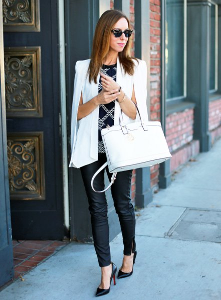 white cape blazer black sweater with silver sequin details
