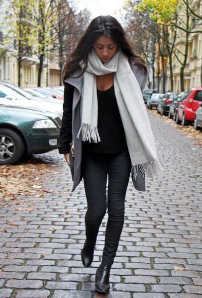 white cashmere scarf black sweater grey vest
