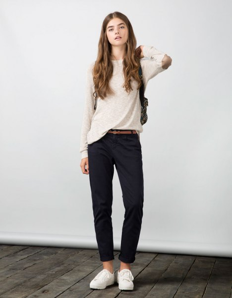white elbow patch sweater with navy chinos