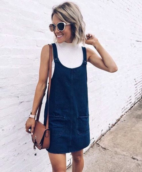 white mock neck ribbed sweater dark blue denim overall dress