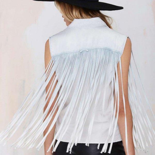 white sleeveless fringe shirt black felt hat