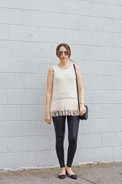 white sleeveless knit sweater black leather leggings