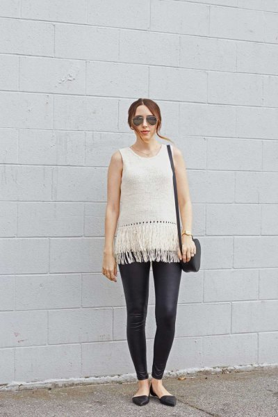 white sleeveless knit sweater black leather leggings