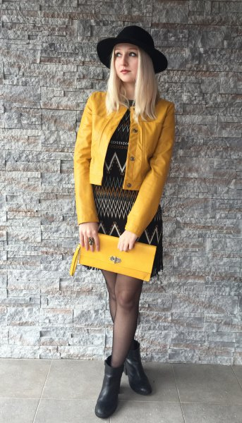 yellow leather jacket black tribal printed shift dress