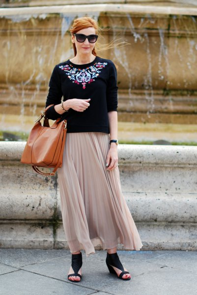 black and silver sweatshirt with pale pink pleated maxi skirt
