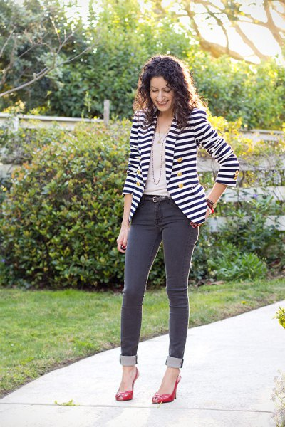 black and white horizontal striped double breasted blazer with grey jeans