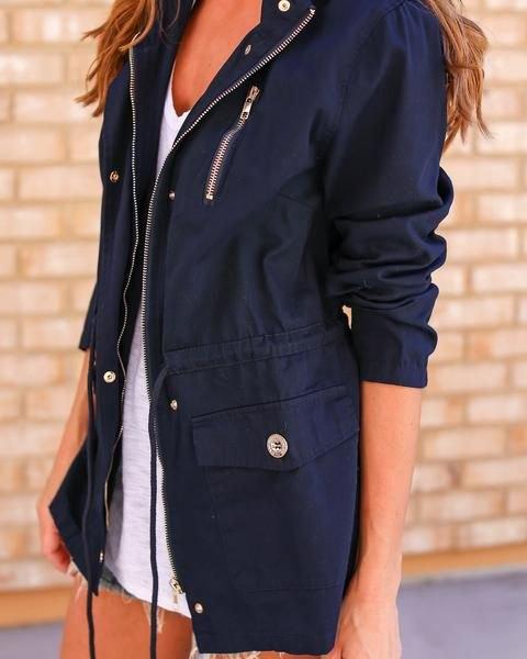 black anorak jacket white v neck vest top denim shorts