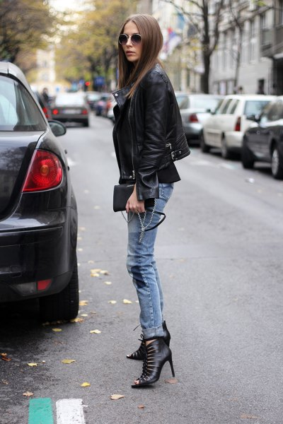 black blazer with greyish blue skinny jeans cutout boots