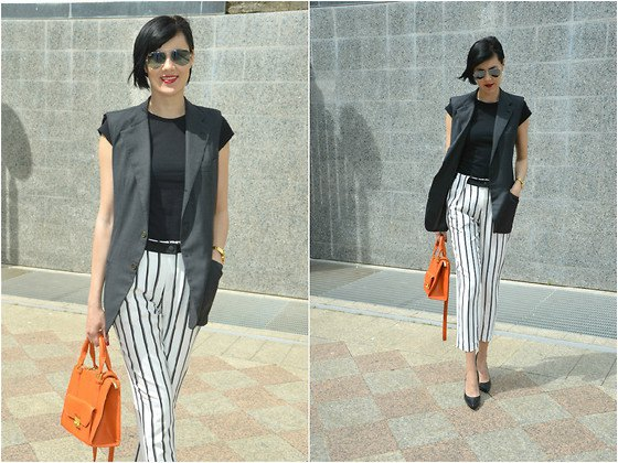 black cap sleeve tee with white striped cropped pants
