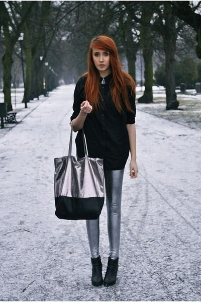 black chunky knit sweater with silver leggings